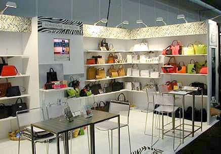 Adrienne Vittadini Handbags booth with hardwall and shelving by Manny Stone Decorators
