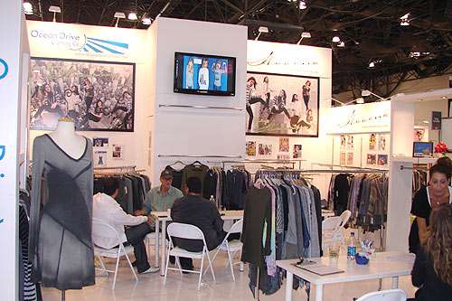 Hardwall trade show booth designed by Manny Stone Decorators