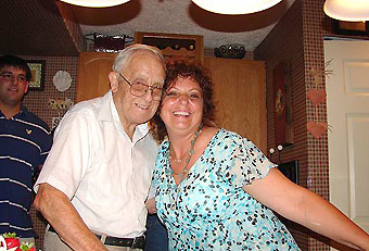 At 89, Robert O. partying in the kitchen with Kathy.